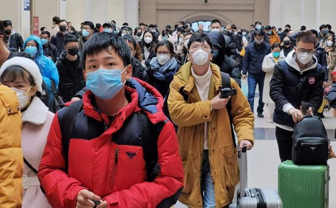 Bắc Kinh xác nhận ca trẻ 9 tháng tuổi nhiễm virus corona đầu tiên - Ảnh 1.