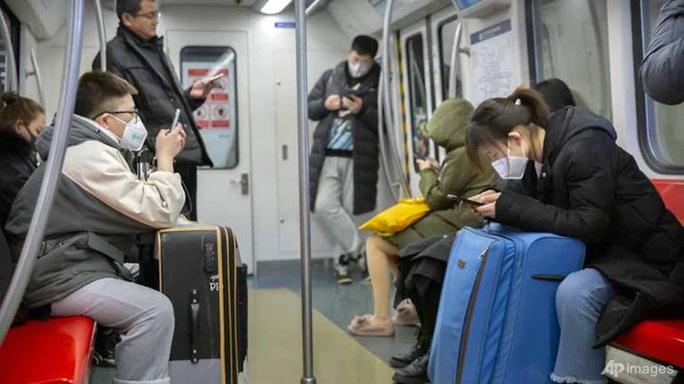 Bắc Kinh xác nhận ca trẻ 9 tháng tuổi nhiễm virus corona đầu tiên - Ảnh 2.