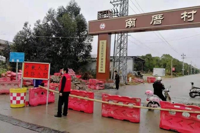 Bắc Kinh xác nhận ca trẻ 9 tháng tuổi nhiễm virus corona đầu tiên - Ảnh 3.