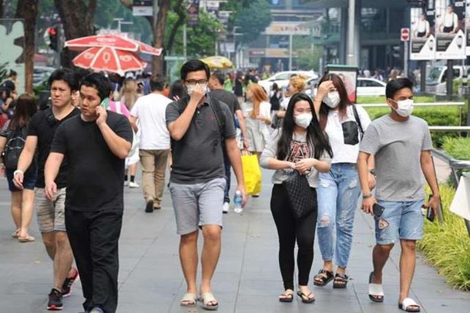 Virus Vũ Hán: Người dân các nước khổ sở săn lùng khẩu trang - Ảnh 2.