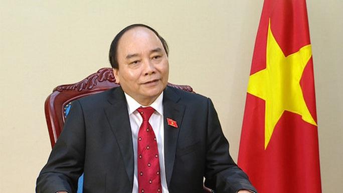 Thủ tướng Nguyễn Xuân Phúc gửi điện tới Thủ tướng Trung Quốc về dịch do virus Corona - Ảnh 1.