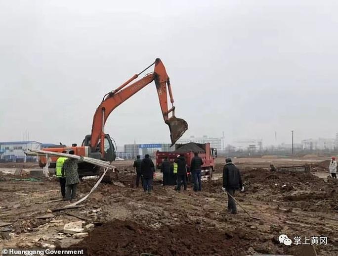 Virus Vũ Hán: Trung Quốc dựng bệnh viện trong… 2 ngày - Ảnh 3.