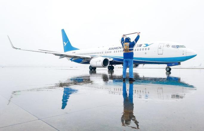 Trung Quốc đưa máy bay đón công dân Vũ Hán về từ Thái Lan, Malaysia - Ảnh 1.