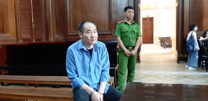 Trộm tiền trên máy bay Vietjet Air, một khách Trung Quốc hầu tòa - Ảnh 1.