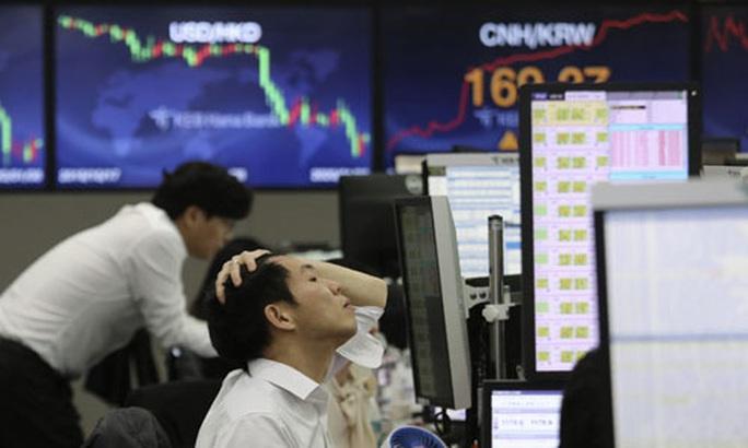 Kinh tế thế giới căng thẳng - Ảnh 1.