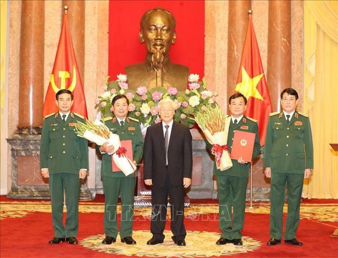 Tổng Bí thư, Chủ tịch nước trao Quyết định thăng quân hàm Thượng tướng cho 2 cán bộ cấp cao Quân đội - Ảnh 1.