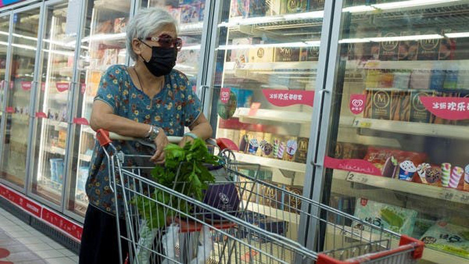 Covid-19: Trung Quốc cảnh báo rủi ro từ bao bì thực phẩm đông lạnh - Ảnh 1.