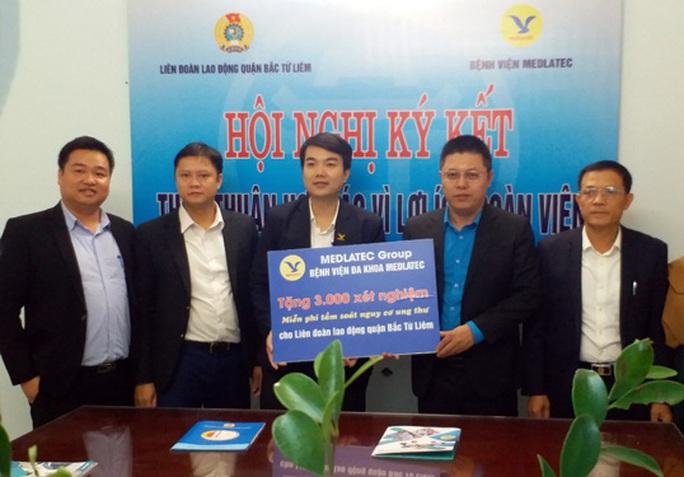 Hà Nội: Hợp tác chăm sóc sức khỏe đoàn viên - Ảnh 1.