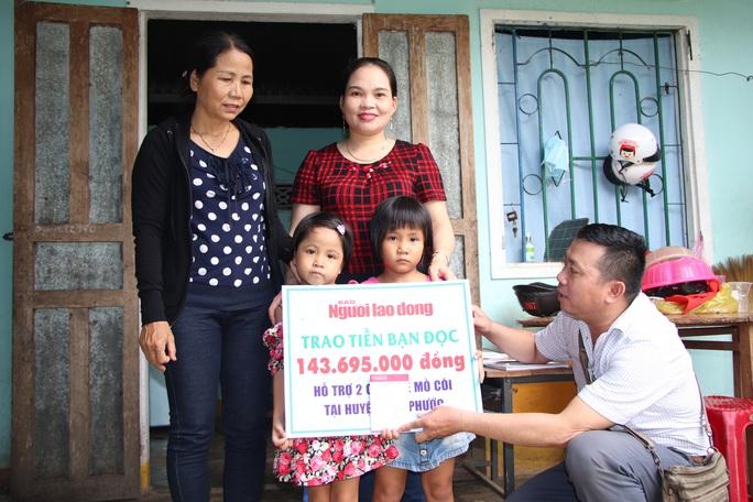 Báo Người Lao Động trao hơn 143,6 triệu đồng cho 2 cháu bé mồ côi ở Quảng Nam - Ảnh 1.