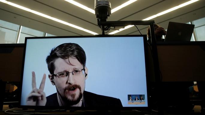 Người thổi còi Snowden xin nhập tịch Nga để… đời con bớt khổ - Ảnh 1.