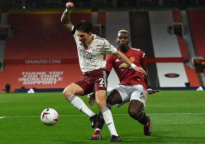 Paul Pogba tạo phạt đền, Man United gục ngã trước Arsenal  - Ảnh 4.