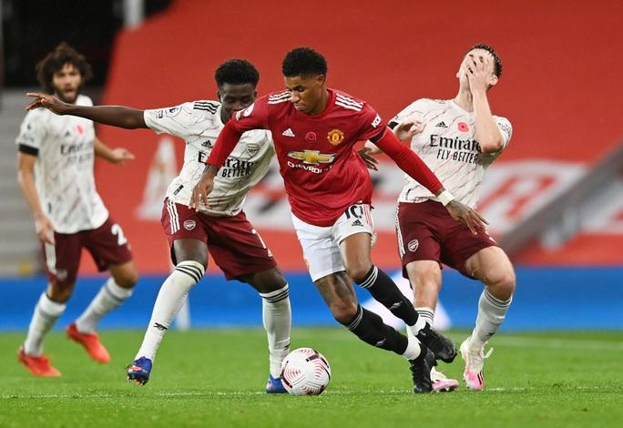 Paul Pogba tạo phạt đền, Man United gục ngã trước Arsenal  - Ảnh 3.