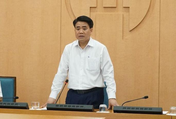 Ông Nguyễn Đức Chung đưa 10.000 USD cho cán bộ C03 để làm gì? - Ảnh 1.