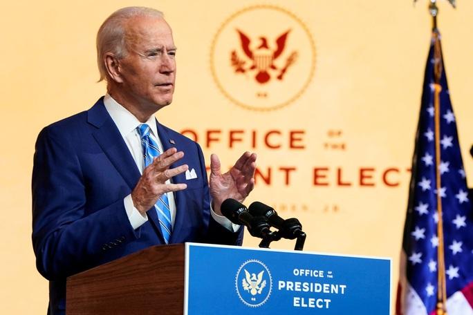 Hai thái cực giữa ông Joe Biden và ông Donald Trump - Ảnh 1.