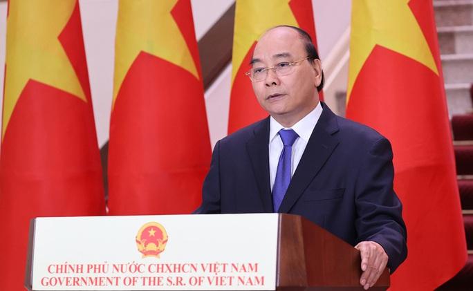 Thủ tướng Nguyễn Xuân Phúc chúc mừng Hội chợ Trung Quốc - ASEAN - Ảnh 1.