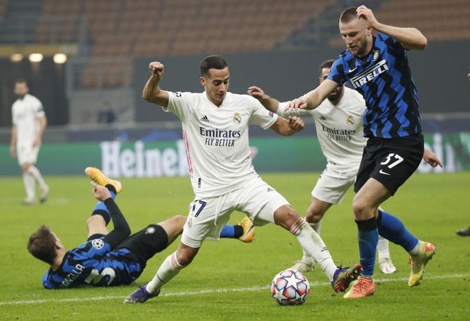 Thẻ đỏ tai hại, Inter Milan trắng tay trước Real Madrid trên sân nhà - Ảnh 1.
