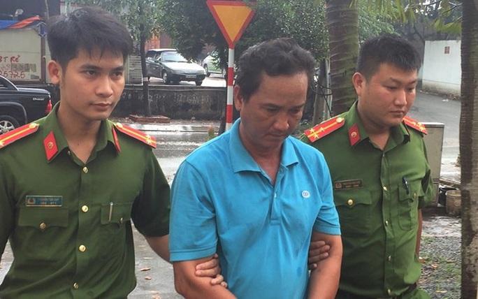 Bắt giam tài xế ben húc xe CSGT ở Đồng Nai - Ảnh 1.