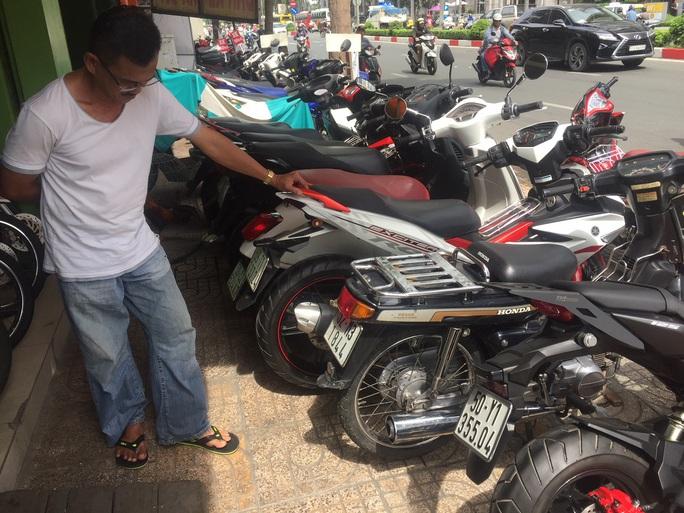 Bán xe máy cũ, phải xác nhận độc thân: Bảo vệ người mua ngay tình - Ảnh 1.