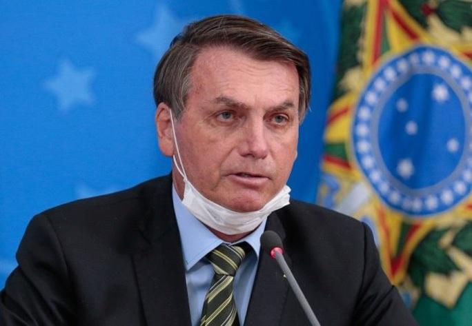 Tổng thống Brazil: Vắc-xin Covid-19 của Mỹ có thể biến người thành cá sấu - Ảnh 1.