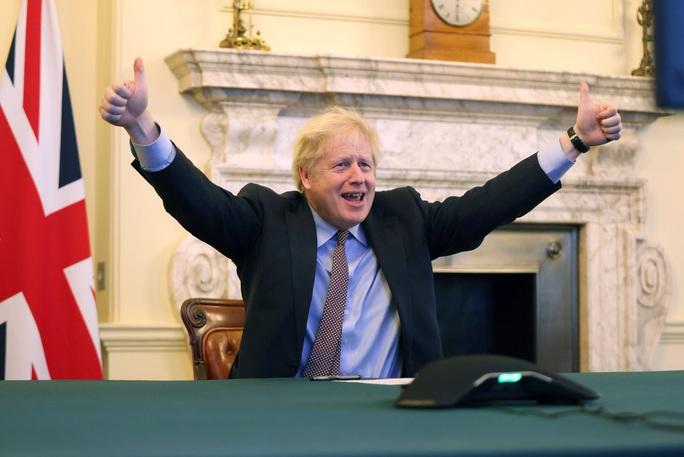 Anh, EU đạt thỏa thuận thương mại hậu Brexit - Ảnh 1.