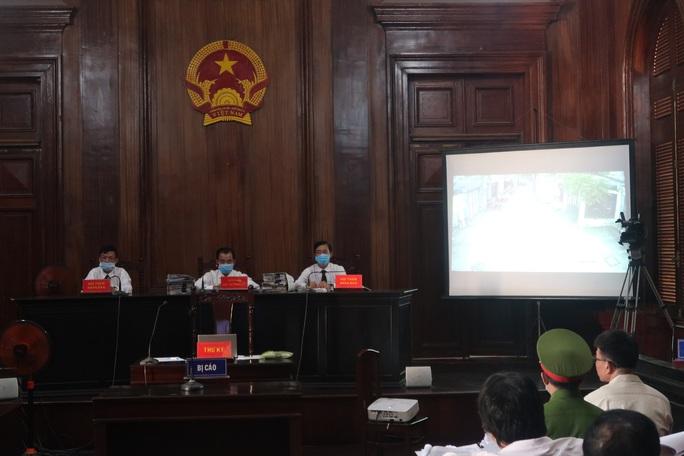 Trình chiếu nhiều clip ghi lại hành vi của cựu thẩm phán Nguyễn Hải Nam - Ảnh 3.