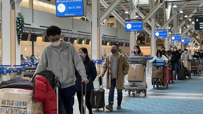 Bốn chuyến bay đưa hơn 1.000 người Việt về nước - Ảnh 2.