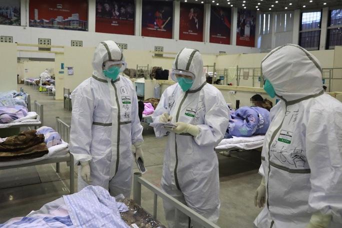 Virus corona (Covid-19): Giới y tế Trung Quốc đối đầu tình thế nguy hiểm - Ảnh 1.