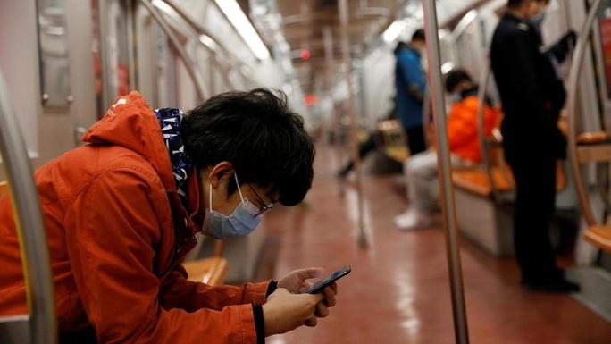 Covid-19: Bắc Kinh kiểm soát người trở về gắt gao chưa từng có - Ảnh 1.