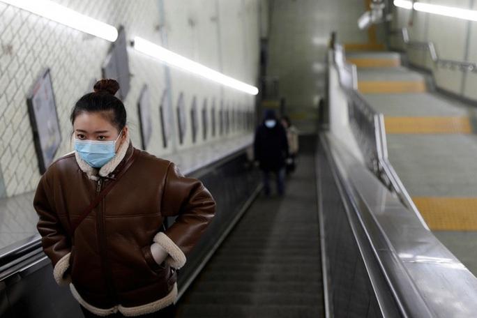 Covid-19: Bắc Kinh kiểm soát người trở về gắt gao chưa từng có - Ảnh 5.