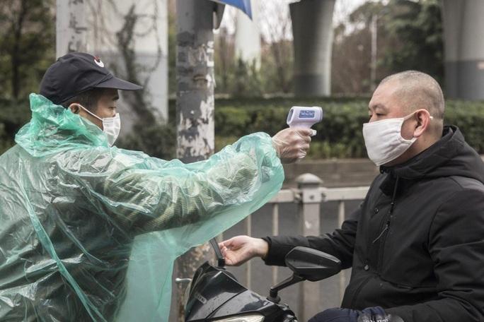 Trung Quốc tăng tốc độ chẩn đoán bệnh nhân nhiễm Covid-19 - Ảnh 1.