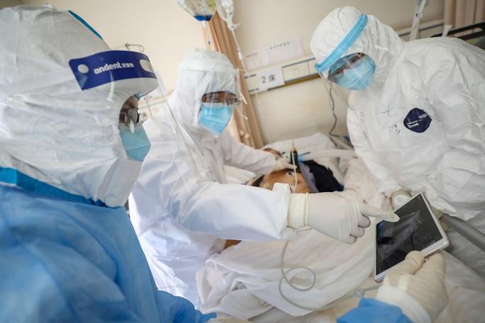 Khẩn trương sản xuất thuốc chống dịch Covid-19 - Ảnh 1.