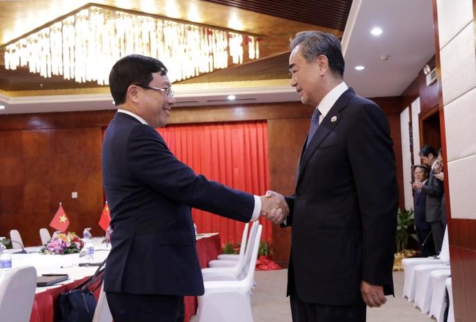 Phó Thủ tướng Phạm Bình Minh gặp Ngoại trưởng Trung Quốc Vương Nghị - Ảnh 1.