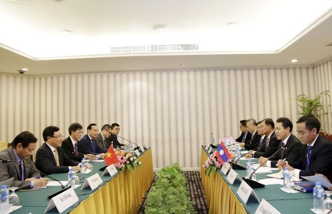 Phó Thủ tướng Phạm Bình Minh gặp Ngoại trưởng Trung Quốc Vương Nghị - Ảnh 4.