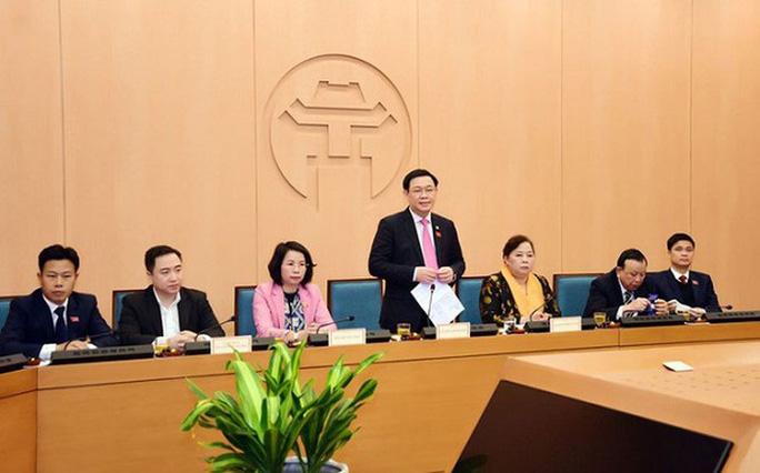 Ủy ban Thường vụ QH phê chuẩn chức danh mới của tân Bí thư Thành ủy Hà Nội Vương Đình Huệ - Ảnh 1.