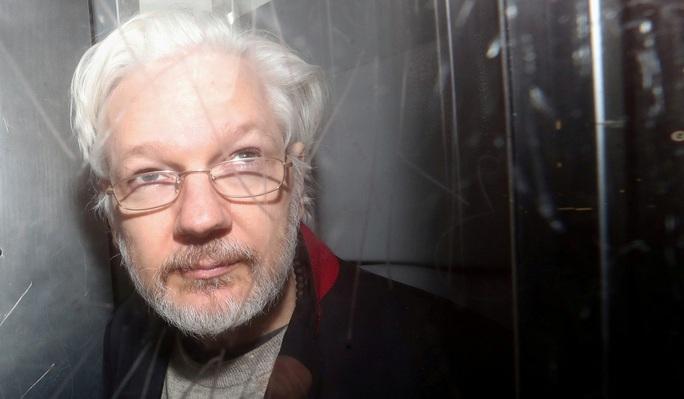 Thực hư chuyện Tổng thống Trump hứa ân xá nhà sáng lập WikiLeaks - Ảnh 1.
