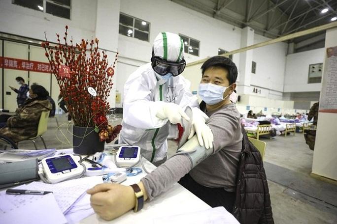 Trung Quốc: Xuất viện 10 ngày, bệnh nhân Covid-19 tái nhiễm - Ảnh 1.
