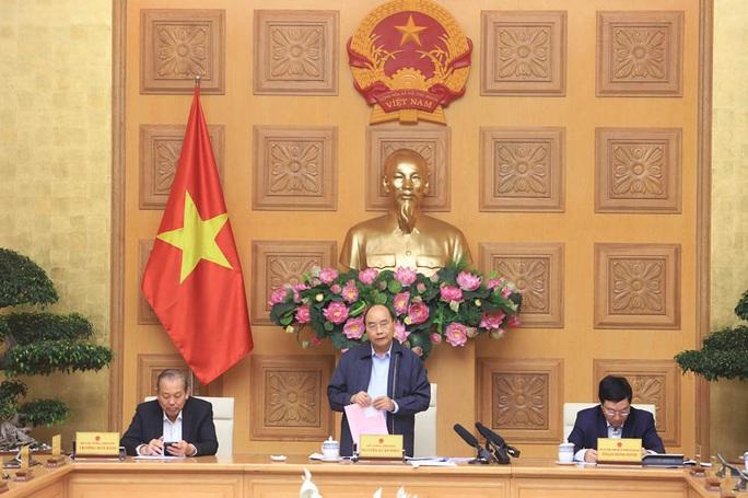 Giữ vững tinh thần Việt Nam chống Covid-19 - Ảnh 1.