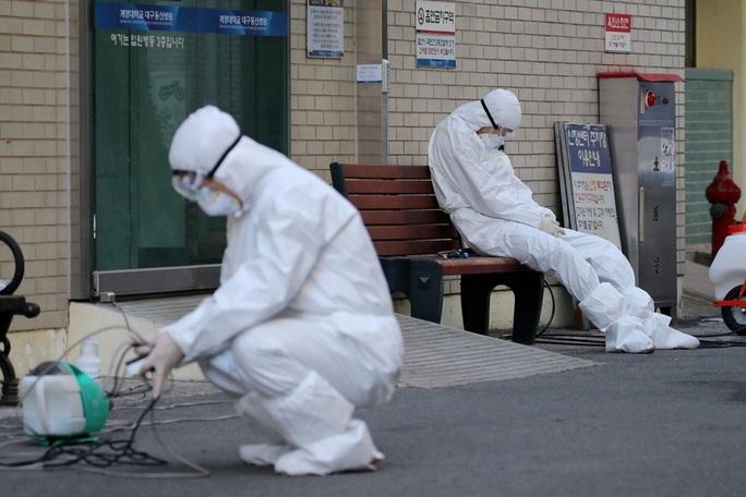 Covid-19: Hàn Quốc ghi nhận ít nhất 763 ca nhiễm và trường hợp tử vong thứ 7 - Ảnh 1.