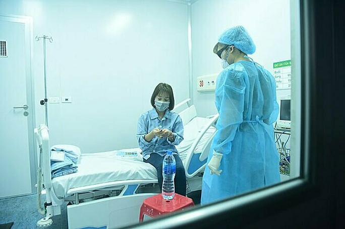 Ca nhiễm virus corona thứ 10 là người quen nữ công nhân trở về từ Vũ Hán - Ảnh 1.