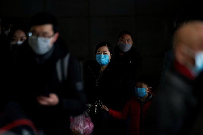 Virus corona mới: 805 người thiệt mạng, vượt qua SARS - Ảnh 1.