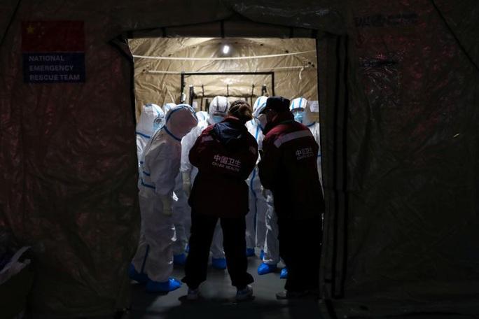 Virus corona: Trung Quốc vẫn lạnh lùng với đề nghị trợ giúp từ WHO và Mỹ - Ảnh 1.