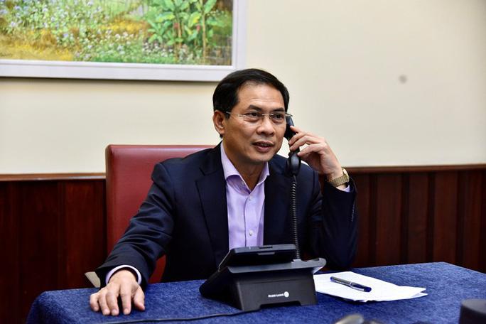 Thứ trưởng ngoại giao Việt Nam - Canada điện đàm, chia sẻ kinh nghiệm phòng chống dịch Covid-19 - Ảnh 1.