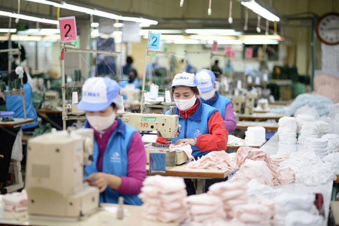 Bộ trưởng Trần Tuấn Anh nói về việc Mỹ và EU ngừng nhập hàng dệt may Việt Nam - Ảnh 1.