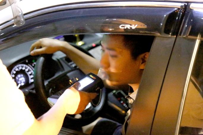 TP HCM có ứng dụng tự đo nồng độ cồn và mức phạt cho lái xe - Ảnh 2.