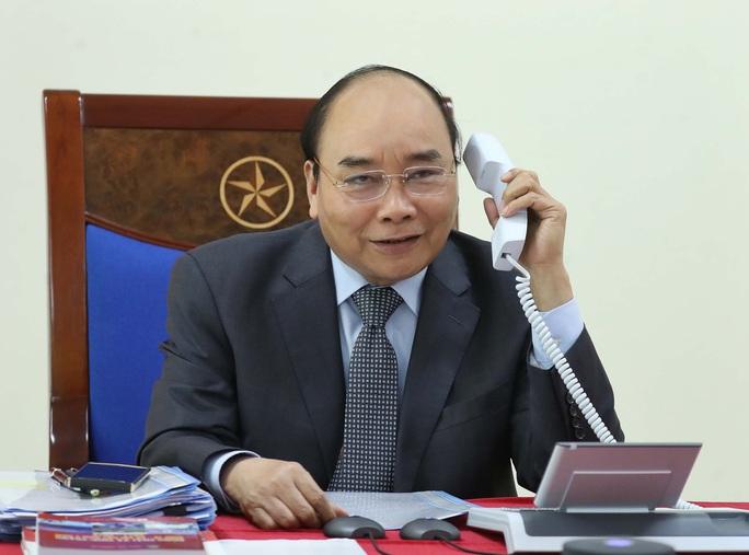 Thủ tướng Nguyễn Xuân Phúc điện đàm với Thủ tướng Lào và Campuchia về chống dịch Covid-19 - Ảnh 1.