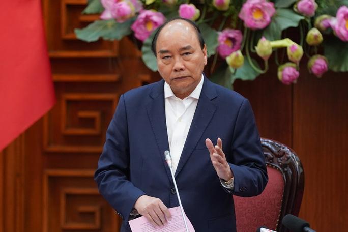 Thủ tướng: Soạn thảo chủ trương, biện pháp trong thời kỳ tiền khẩn cấp chống dịch Covid-19 - Ảnh 1.