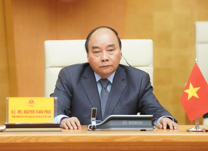 Thủ tướng chia sẻ với lãnh đạo G20 thực tiễn kiểm soát tốt dịch Covid-19 của Việt Nam - Ảnh 1.