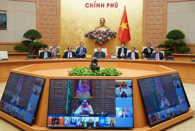 Thủ tướng chia sẻ với lãnh đạo G20 thực tiễn kiểm soát tốt dịch Covid-19 của Việt Nam - Ảnh 2.