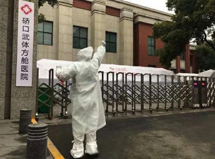 Vũ Hán đóng cửa bệnh viện dã chiến, không ca tử vong mới ngoài Hồ Bắc - Ảnh 1.