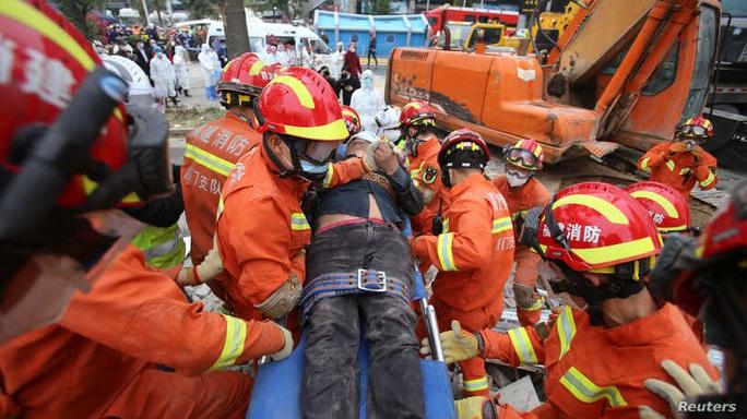 Covid-19 tại Trung Quốc: 40 ca nhiễm mới, 28 người bị cách ly mất tích trong vụ sập khách sạn - Ảnh 1.